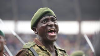 A member of the Zimbabwean National Army shouts orders as soldiers march past President Robert Mugabe (not in the picture) on Tuesday at the National Sports Stadium in Harare, Zimbabwe.