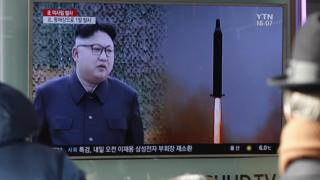 South Koreans watch a North Korean TV broadcast about the missile test, Seoul (12 Feb)