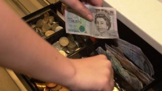 A £5 note and a till