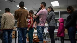 Migrants wait to receive food at the Casa del Refugiado, or The House of Refugee, a new centre opened by the Annunciation House to help the large flow of migrants being released by the United States Border Patrol and Immigration and Customs Enforcement in El Paso, Texas