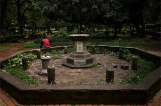 "A man rests on the octagon surrounding the destroyed plinth upon which a colonial era statue of H.M. Queen Victoria had stood in memoria since it""s unveiling in 1906, at the Jevanjee gardens in Nairobi on June 13, 2020. - The statue was removed following a vandalism incident a few years ago. Statues of controversial historical and political figures are under scrutiny worldwide."