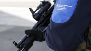 A Swiss border guard controls the area at the Bardonnex border, 11 Dec
