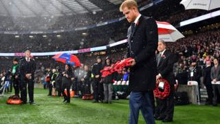 Prince Harry, Duke of Sussex, walks to lay a wreath on the pitch ahead of the autumn international rugby union match between England and New Zealand