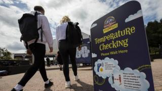 sports Visitors to Alton Towers walk past temperature testing