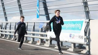 Brothers Martin, 13, (right) and Mark McFarlane from Glasgow sprint across the Queensferry Crossing