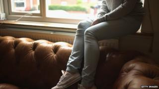Child sat on a sofa