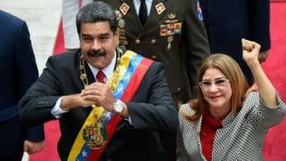 Venezuelan President Nicolas Maduro and his wife Cilia Flores arrive at the Congress for the inauguration ceremony in Caracas.