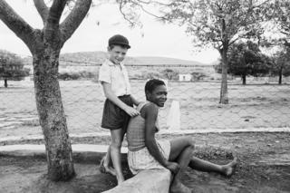 A farmer's son with his nursemaid, Heimweeberg, Nietverdiend, Western Transvaal. 1964.