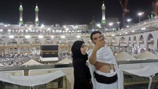 Muslim pilgrims take a selfie inside Mecca's Grand Mosque at the start of the Hajj (30 August 2017)