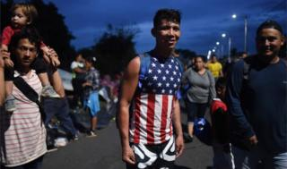 A young Honduran migrant wearing an American flag t-shirt