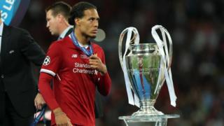 Virgil Van Dijk with Champions League trophy