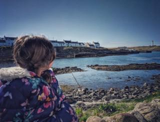 girl looking towards Portnahaven, Islay