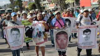 Relatives of the 43 missing students protest with their portraits at the central square in Chilpancingo, Guerrero State, Mexico on September 15, 2015.