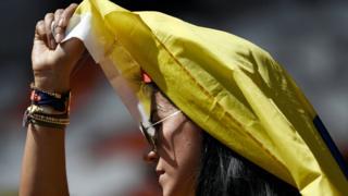 Colombia fan shelters from sun