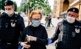Photojournalist Victoria Ivleva is led away by police outside the interior ministry in Moscow