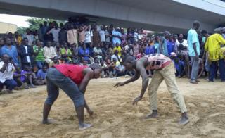 Men about to wrestle in front of a crowd - Sunday 14 April 2019