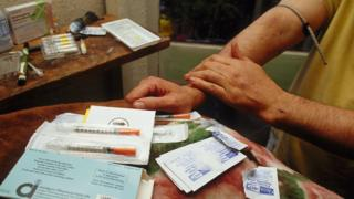 A registered heroin addict inject the drug on prescription