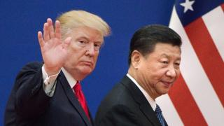 """This file picture taken on November 9, 2017, shows US President Donald Trump (L) and China""""s President Xi Jinping leaving a business leaders event at the Great Hall of the People in Beijing"""