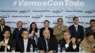 Jesus Torrealba (C), secretary of Venezuela's coalition of opposition parties (MUD), talks to the media next to his fellow politicians during a news conference in Caracas March 8, 2016.