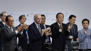 Participants in negotiating the climate deal applaud its agreement in Paris, 2015