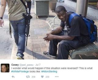 Tweet of black man sitting on bench as whote man with assault rifle passes by