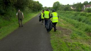 Offenders picking litter