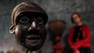 A Runner Mask, 'Mabu' from the Wum people, Cameroon, 1930s (estimate £5500 - 7,500) stands during a press preview at Summers Place Auctions on May 30, 2018 in Billingshurst, England