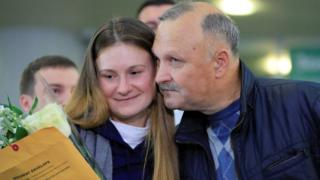 Maria Butina is welcomed by her father Valery Butin upon arrival at Sheremetyevo International Airport outside Moscow