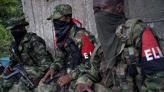 Rebels from Colombia's Marxist National Liberation Army (ELN) take a rest outside a farmer's home, in the northwestern jungles, Colombia on 31 August 2017