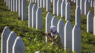 Woman prays at the Potocari cemetery and memorial near Srebrenica. File photo