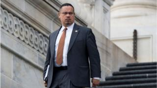 Keith Ellison walking down House of Representatives steps