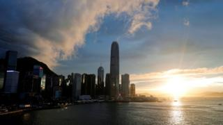 """Skyscrapers at Hong Kong""""s central business district are seen during sunset, China, June 13, 2019"""