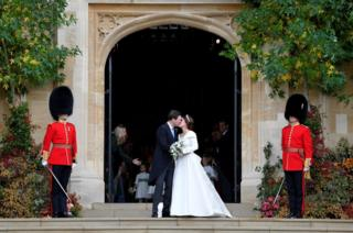 Princess Eugenie and Jack Brooksbank kiss as they leave after their wedding at St George's Chapel in Windsor Castle,