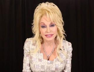 A screengrab from a video posted by Official Dolly Parton, where the singer promises help for victims of the wildfires in her native Tennessee