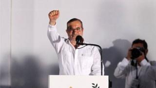 Farc rebel leader Rodrigo Londono, better known by the nom de guerre Timochenko, gestures while addressing the audience in Cartagena, Colombia September 26, 2016