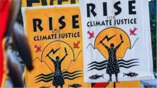 """Банери """"Встанемо на захист клімату"""" в США"""