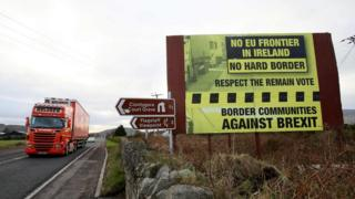 A lorry passes and anti-Brexit sign on a road close to the Irish border