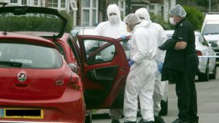 Police searching a car in Luton
