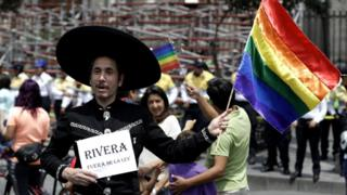 LGBT demonstration outside of Mexico City's Metropolitan Cathedral in Mexico City, Sunday, Sept. 11, 2016.