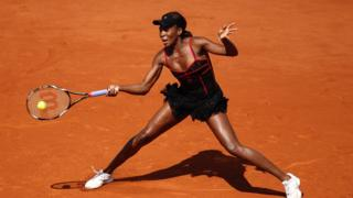 Venus Williams sports a black and red lacy dress at the French Open in Paris in 2010.