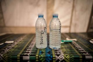 Water samples lie on a table at a Red Cross water treatment plant