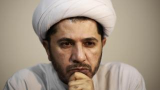 "Bahrain""s Al-Wefaq opposition group leader Sheikh Ali Salman looks on during a rallly in November 2014"