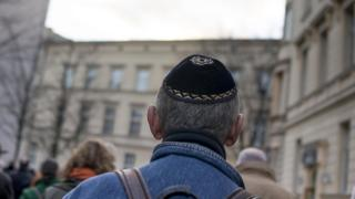 A man wears a kippa as he takes part in a silent march to commemorate the 75th anniversary of the Kristallnacht pogroms on November 9, 2013 in Berlin, Germany