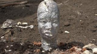 Bronze head from Igun street