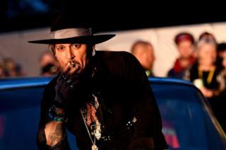 Actor Johnny Depp smokes a cigarette for the camera
