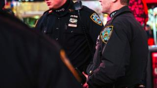 New York City Police Department (NYPD) officers stand guard at a busy street in New York City, New york, USA, 07 November 2016.