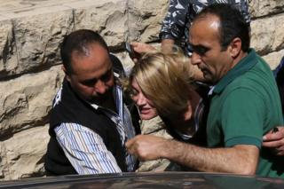 Australian journalist Tara Brown is escorted from a Beirut court on Monday