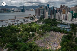 This sweeping panorama of Hong Kong, overlooking Victoria park, shows hundreds if not thousands of people staged for the march in the morning or early afternoon.