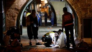 Investigators at the site of an attack where two Israelis were killed and two wounded, Jerusalem (3 October)