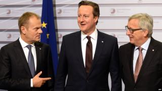 UK Prime Minister David Cameron (C) with President of the European Council Donald Tusk (L) and European Commission President Jean-Claude Juncker